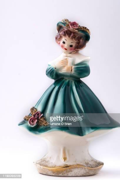 porcelain vintage girl figurine with prayer