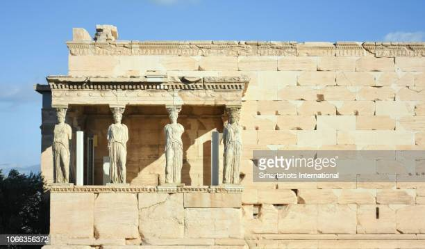 porch of the caryatids in the erechtheion with copy space, temple of athena and poseidon of the acropolis, athens, greece, - cultura griega fotografías e imágenes de stock
