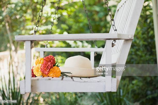 Porch Swing with Sun Hat and Bouquet