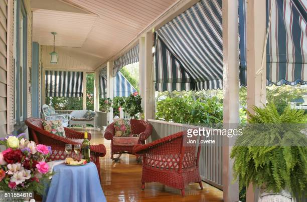 Porch with wine and red painted wicker