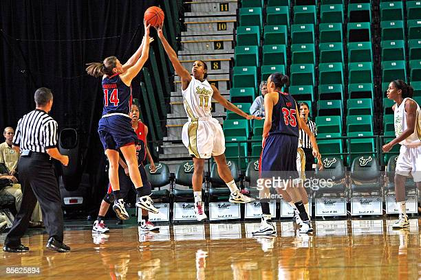 Porche Grant of the South Florida Bulls blocks Elizabeth Robertson of the Mississippi Rebels during the Women's National Invitational Tournament game...