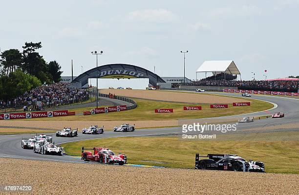 Porche Team driven by Romain Dumas Neel Jani and Marc Lieb leads at the start of the Le Mans 24 Hour race at the Circuit de la Sarthe on June 13 2015...