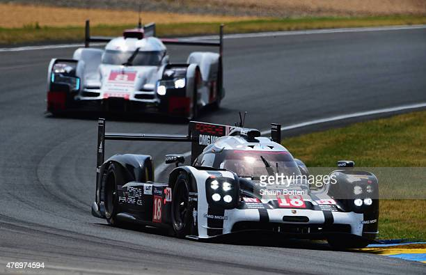 Porche Team driven by Romain Dumas Neel Jani and Marc Lieb leads during the Le Mans 24 Hour race at the Circuit de la Sarthe on June 13 2015 in Le...