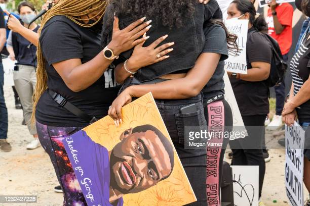 Porchse Queen Miller , Hannah Gebresilassie and Qri Montague embrace before joining other people marching through the streets after the verdict was...
