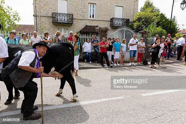PorcieuAmblagnieu RhoneAlpes France August 25 2013 The agriculture fair of Porcieu People parade in the street of the village