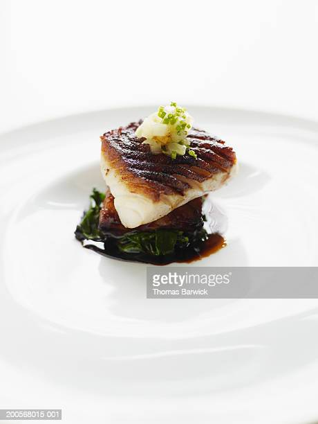 Porcini dusted black cod with lacquered pork belly and fennel confit