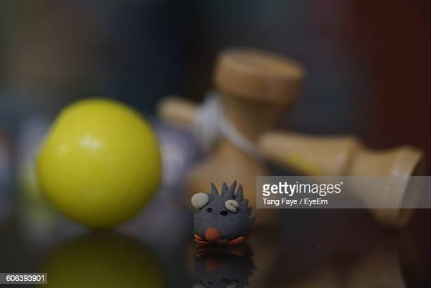 Porcupine Toy And Kendama On Table