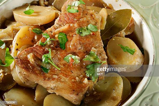 Pork and potatoes seasoned with a Latin twist make a lean and satisfying main dish
