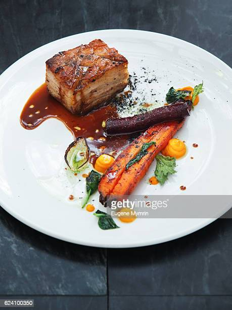 Pork belly and vegetables with demi-glace sauce