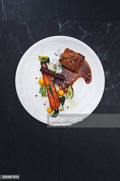 pork belly and vegetables with demi-glace sauce - gourmet stock pictures, royalty-free photos & images