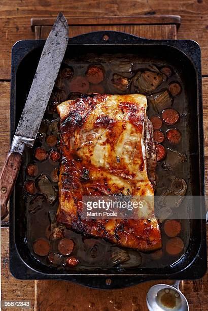 Pork belly in roasting pan with veg