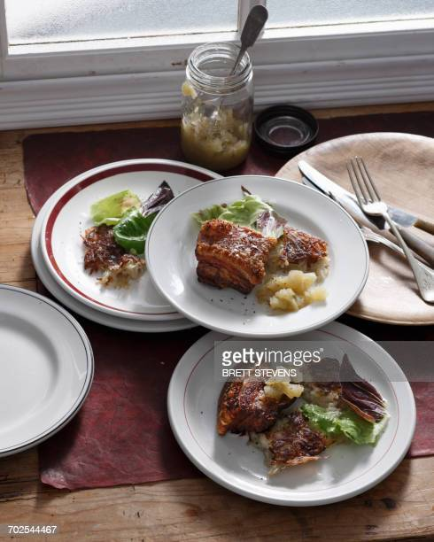 Pork belly with apple sauce and salad greens