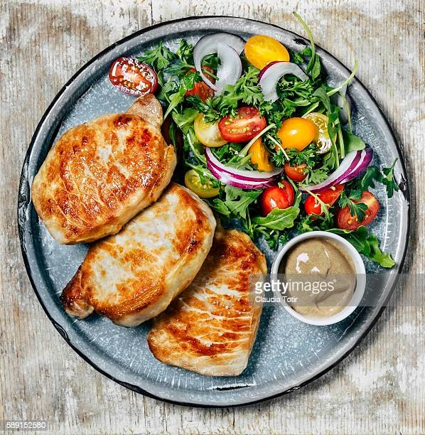 Pork chops with salad