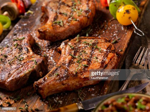 bbq pork chops with vegetable skewers - chop stock pictures, royalty-free photos & images