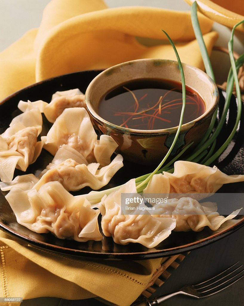 Pork dumplings with soy sauce : Stock Photo
