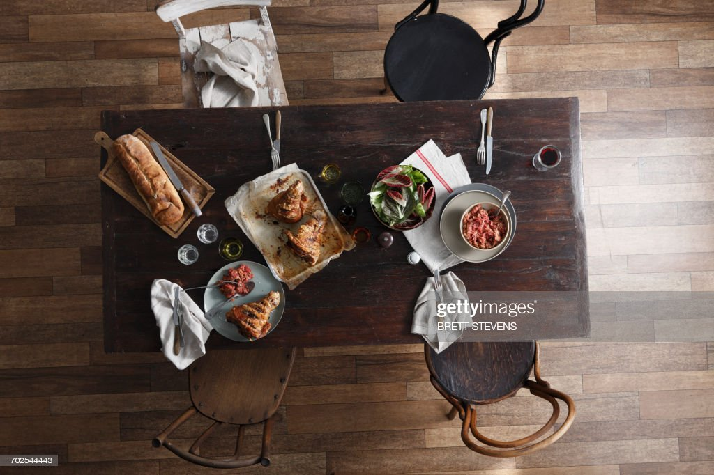 Pork Hock Salad And Fresh Bread On Restaurant Table Overhead View Stock Photo