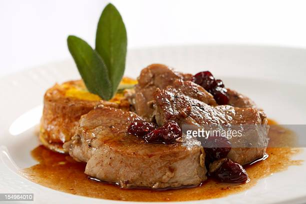 pork loin medallions in port wine sauce - medallion stock photos and pictures