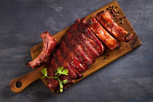 Pork loin ribs served on chopping board 1190400491