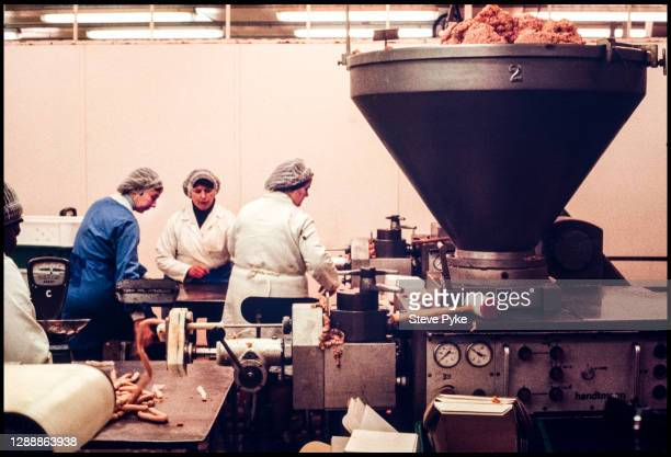 Pork meat being processed into sausages at a Norfolk abattoir, 1981.