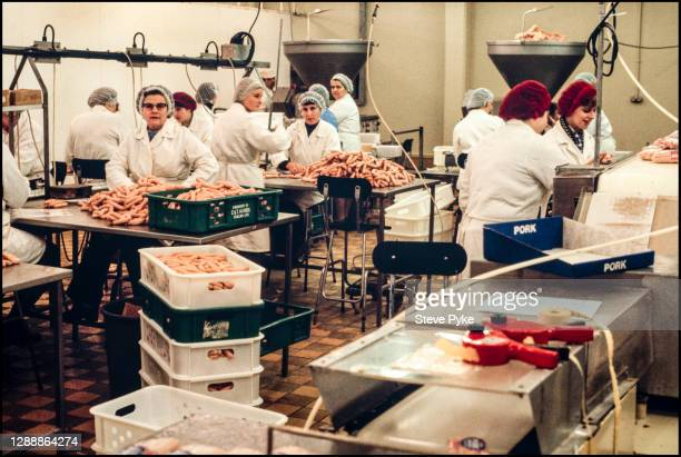 Pork meat being processed into sausages at a Norfolk abattoir, March 1981.
