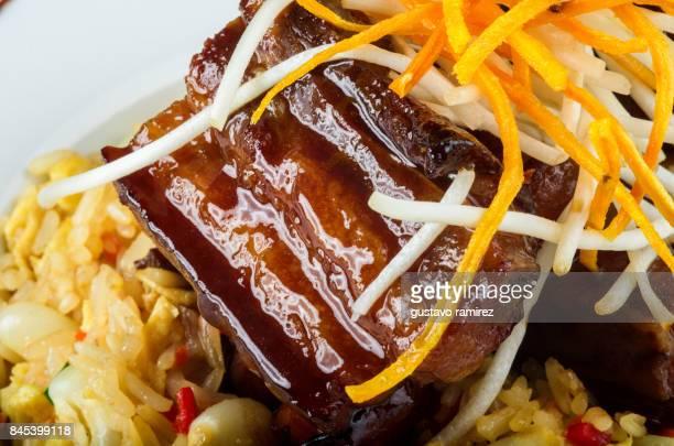 pork meat glazed with rice chaufa