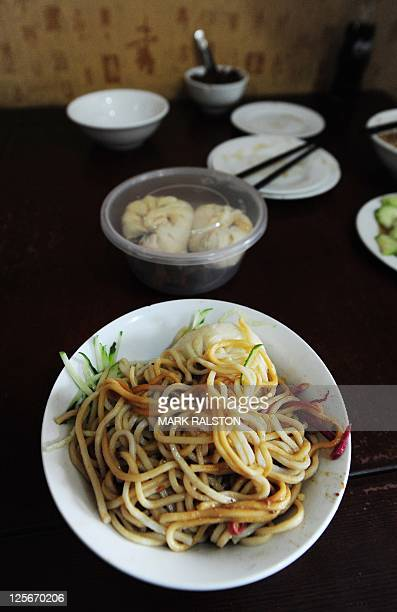 'Pork Noodles in Brown Bean Sauce' in the crowded the Yaoji Chaogan restaurant after the restaurant's popularity soared due to US Vice President Joe...