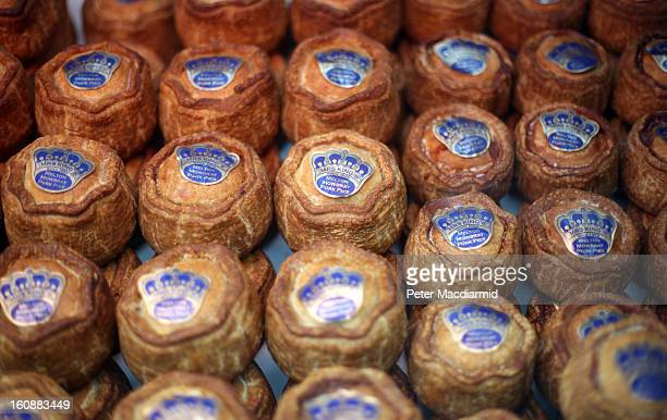 Pork pies are dsplayed at Borough Market on February 7 2013 in London England Borough Market London's oldest since 1756 has recently completed...