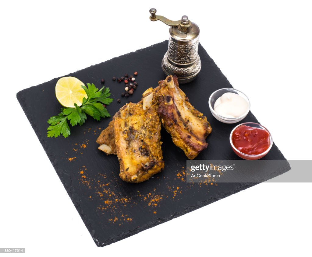 pork ribs on black stone plate stock photo getty images