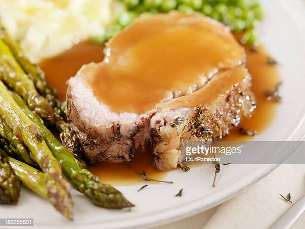 pork roast dinner with gravy - pork stock pictures, royalty-free photos & images