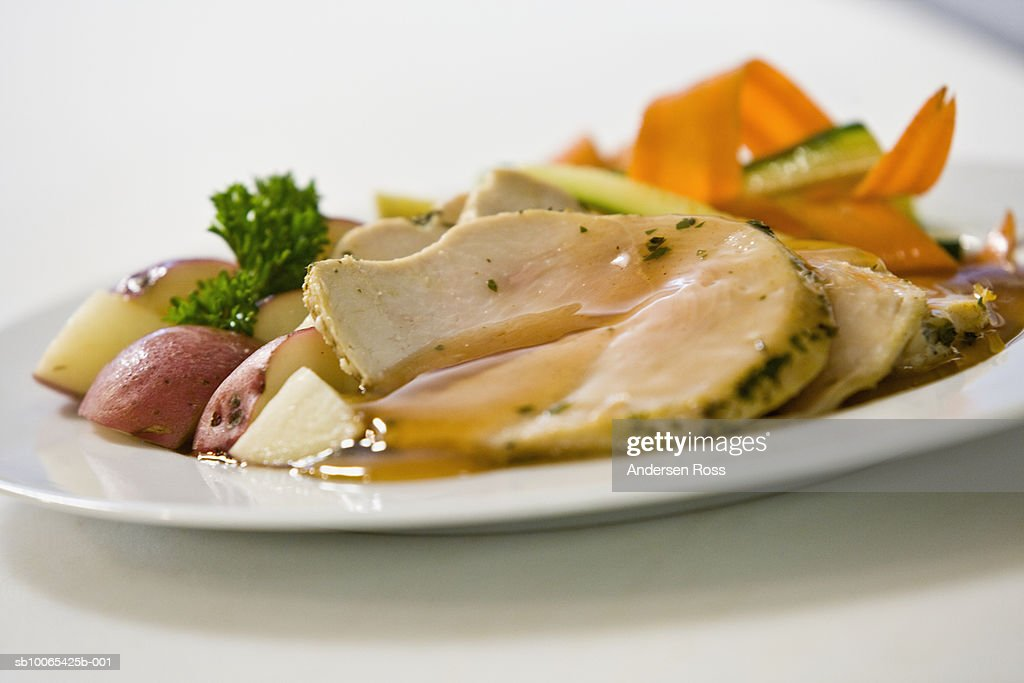 Pork roast, potatoes and vegetables on plate : Foto stock
