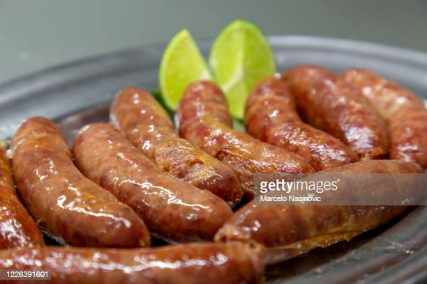 pork sausage - marcelo nacinovic stock pictures, royalty-free photos & images