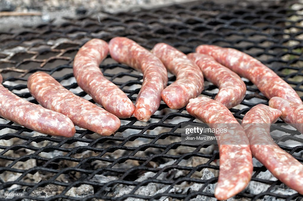 Pork sausages on a barbecue : Photo