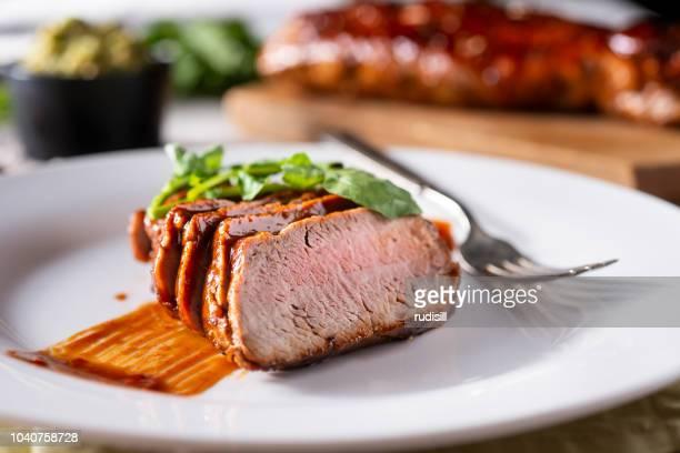 lomo de cerdo - salsa fotografías e imágenes de stock
