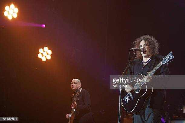 Porl Thompson and Robert Smith of The Cure perform at the O2 Arena on February 26 2009 in London England