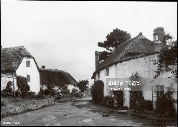 Porlock Weir, Porlock, West Somerset, Somerset, 1930s. The view looking south east along the B3225 at Porlock Weir with Gibraltar Cottages to the...