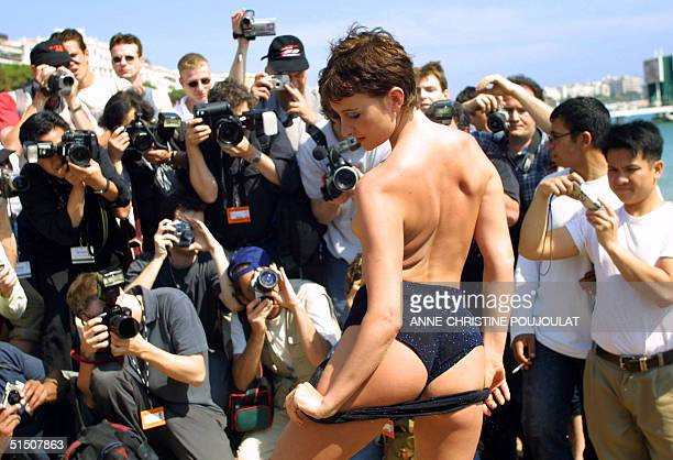 porn actress Celine poses at Long Beach during the Hot d'Or photocall on the sidelines of the 54th Cannes Film Festival 15 May 2001 Best actress...