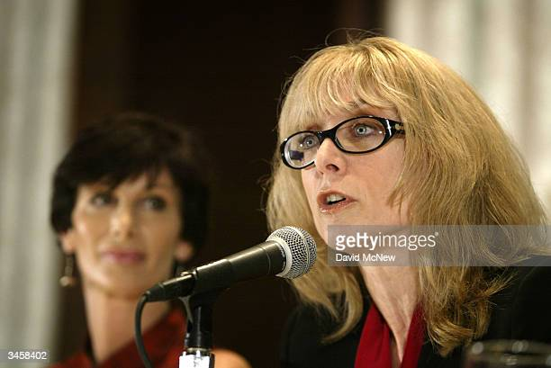 Porn actress Nina Hartley speaks as former porn actress and cofounder of AIM HealthCare Foundation Dr Sharon Mitchell looks on during an AIM press...