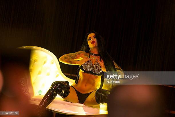 A porn actress performs during the 20th Venus Erotic Fair in Berlin Germany on October 13 2016