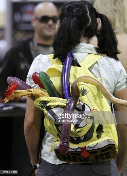 A porn actress wears a backpack filled with rubber dildos during the 2007 AVN Adult Entertainment Expo at the Sands Convention Center January 10 2007...
