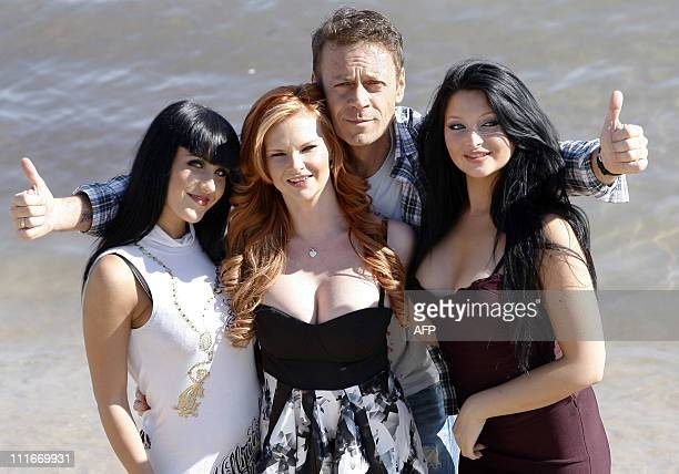 Porn Movie actors Jade Laroche Tarra White Rocco Siffredi and Anna Polina pose during a photocall on April 5 2011 in Cannes southern France part of...