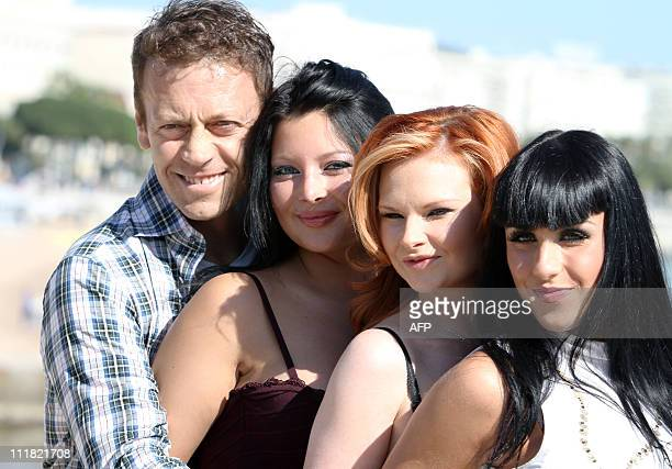 Porn Movie actors Rocco Siffredi Anna Polina Tarra White and Jade Laroche pose during a photocall on April 5 2011 in Cannes southern France part of...