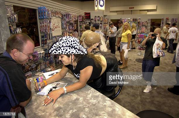 Porn star Felony signs an autograph at the fifth annual Erotica LA adult entertainment trade show July 14 2001 in Los Angeles CA The convention is...