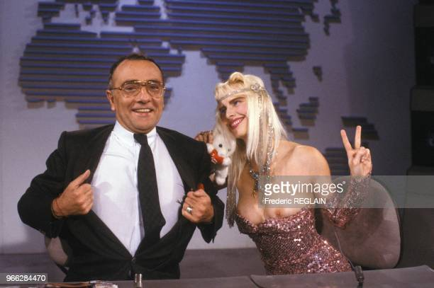 Porn star La Cicciolina topless on TF1 news set with anchorman Yves Mourousi on July 27 1987 in Paris France