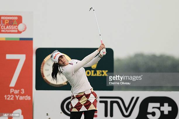 Pornanong Phatlum of Thailand plays a tee shot during the third round of the Reignwood LPGA Classic at Pine Valley Golf Club on October 5 2013 in...