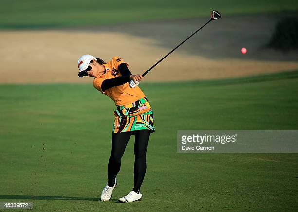Pornanong Phatlum of Thailand plays her second shot on the par 5, 10th hole during the first round of the 2013 Omega Dubai Ladies Masters on the...