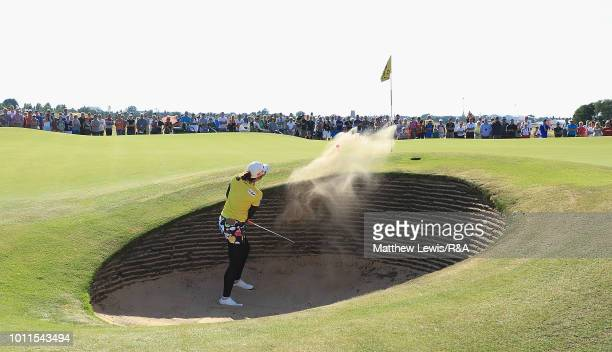 Pornanong Phatlum of Thailand plays out of a bunker on the 12th hole during day four of the Ricoh Women's British Open at Royal Lytham St Annes on...