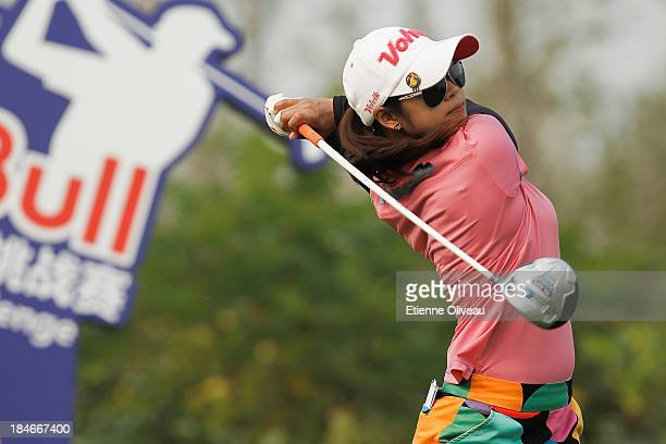 Pornanong Phatlum of Thailand tees off during the second round of the Reignwood LPGA Classic at Pine Valley Golf Club on October 4 2013 in Beijing...