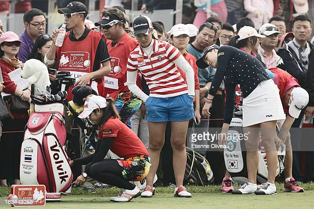 Pornanong Phatlum of Thailand with Xiyun Lin of China and So Yeon of South Korea warm up and get ready to start during the final round of the...