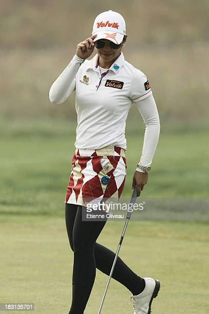 Pornanong Phatlum salutes the public during the third round of the Reignwood LPGA Classic at Pine Valley Golf Club on October 5 2013 in Beijing China