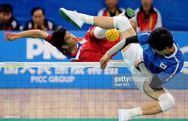 Pornchai Kaokaew of Thailand competes against Yoo Dong Young of South Korea at the Sepaktakraw men's team preliminary round group A game during the...